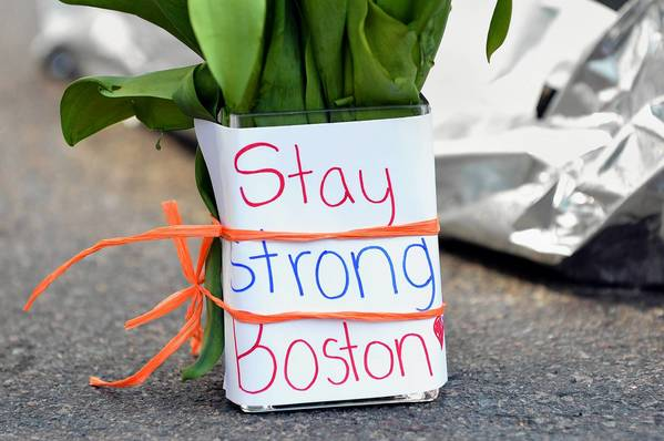 Flowers and a message are left on Newbury Street in Boston, Massachusetts, a few blocks from where two explosions struck near the finish line of the Boston Marathon on Monday.