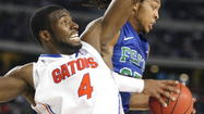 Florida center Patric Young underwent surgery last Friday to remove a bone spur in his right ankle, UF confirmed Tuesday.