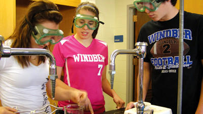 Students Cassie Wentz, Lexi Wahl and Devon Tomlinson conduct an experiment in Andrew Singles chemistry class at Windber Area High School. The school district was ranked among the top 12 percent of schools statewide based on standardized test scores