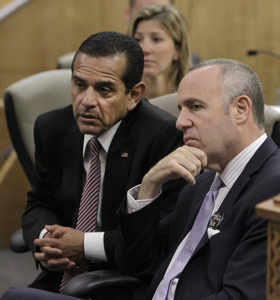 Los Angeles Mayor Antonio Villaraigosa, left, and Senate President Pro Tem Darrell Steinberg, D-Sacramento, listen as members call for the passage of Steinberg's measure to outlaw rifles with detachable magazines, while appearing before the Senate Public Safety Committee on Tuesday.