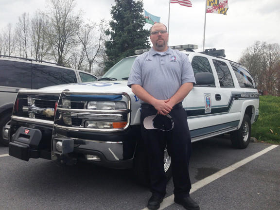 Damien Teal, assistant chief of Sharpsburg Area Emergency Medical Service, stands in front of a chase unit at the Washington County Agricultural Center.