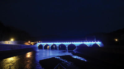 The Johnstown Stone Bridge glowed blue and yellow Tuesday night.