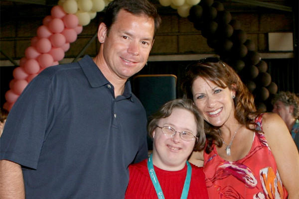 Jim Mora, left, and his wife, Shannon, right, with Special Olympic athlete and fellow Special Olympic board member, Angela Martin at the opening ceremonies of Summer Games, 2009.