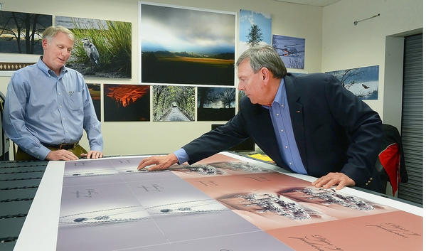 HBP Inc. President John Snyder, left, and Vice President Stu Mullendore look over products printed at the company's plant on Frederick Street in Hagerstown. HBP was one of the businesses recognized Tuesday at the Hagerstown-Washington County Economic Development Commission's annual Celebration of Business.
