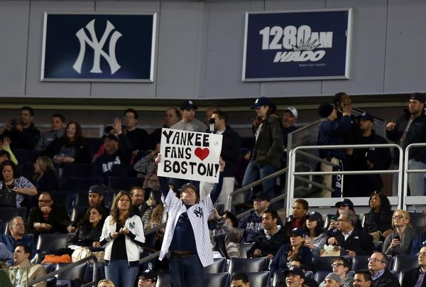 Apr. 16, 2013; Bronx, NY, USA; New York Yankees fan holds a sign in support of the victims of the Boston Marathon bombings during the third inning of a game against the Arizona Diamondbacks at Yankee Stadium. Mandatory Credit: Debby Wong-USA TODAY Sports ORG XMIT: USATSI-120710