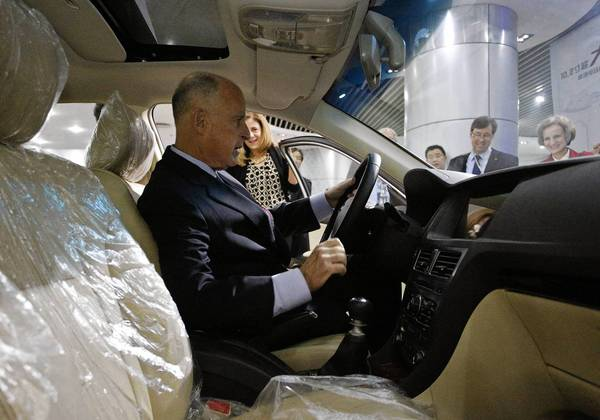 California Gov. Jerry Brown sits in an electric car during a visit to the headquarters of Chinese auto maker BYD on Tuesday in Shenzhen.