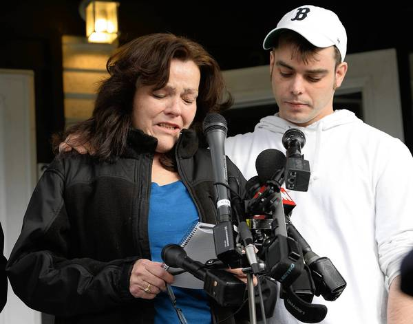 Patty Campbell is consoled by her son, Billy, in Medford, Mass. Her daughter, Krystle, was one of the three people killed in the Boston Marathon bombing.