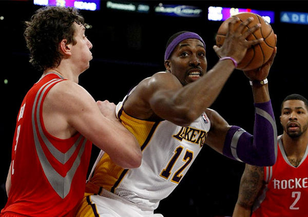 Lakers center Dwight Howard, middle, and Houston Rockets center Omer Asik, left, will be the key matchup in regular-season finale.
