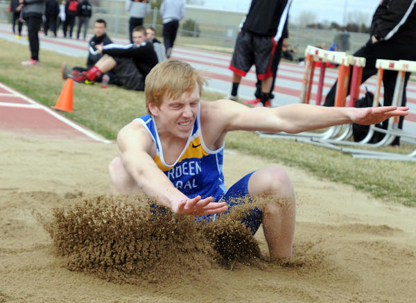 Aberdeen Central's Mitch Guthmiller competes in the boys' long jump at a track and field meet in Yankton on Tuesday.