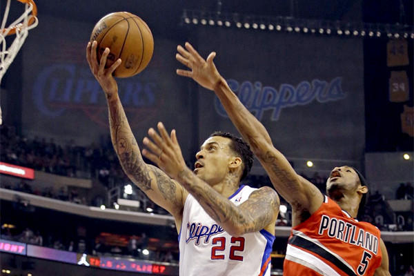 Matt Barnes shoots as Will Barton defends during the first half of the Clippers matchup with the Portland Trail Blazers on Tuesday.
