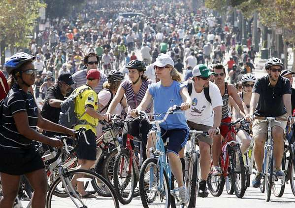 Thousands of bicyclists pedal up and down Spring Street in downtown Los Angeles during the fifth CicLAvia in October.