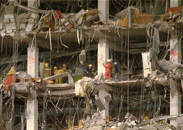 Investigators examine the wreckage of the Alfred P. Murrah Federal Building in 1995.