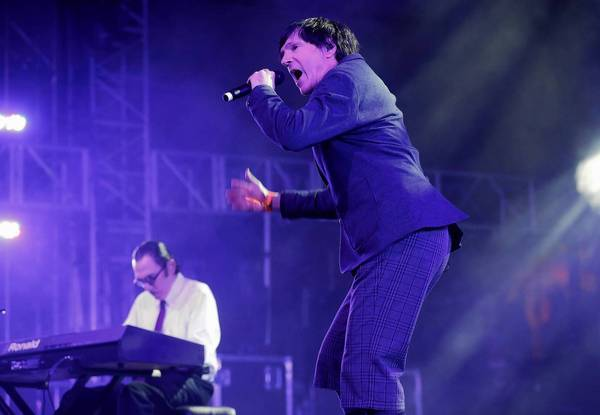 Russell Mael of the band Sparks with brother Ron perform at Coachella.