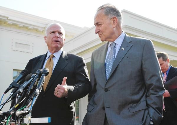 Sens. John McCain (R-Ariz.), left, and Charles E. Schumer (D-N.Y.) speak to reporters after meeting with President Obama to discuss the bipartisan immigration proposal.