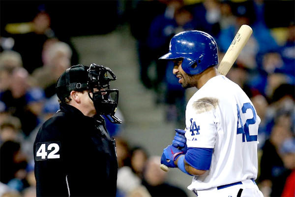 Matt Kemp has a word with home plate umpire Paul Schrieber after being called out on strikes in the seventh inning of the Dodgers' 6-3 loss to the Padres.