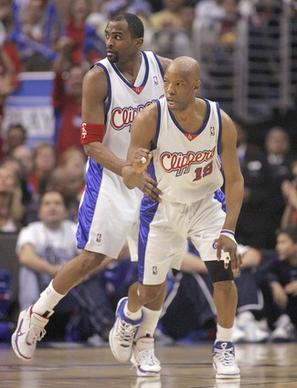 Clipper Sam Cassell, front, pumps his fist after hitting a shot as teammate Cuttino Mobley looks on.