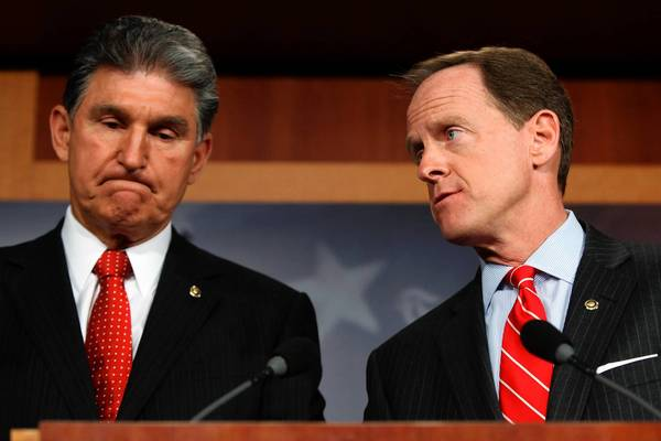 Sens. Joe Manchin III (D-W.Va.), left, and Patrick J. Toomey (R-Pa.) talk to reporters.