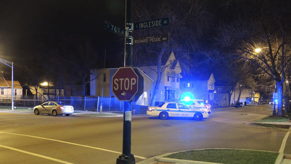 Police block East 76th Street in the Grand Crossing neighborhood near where a 45-year-old m