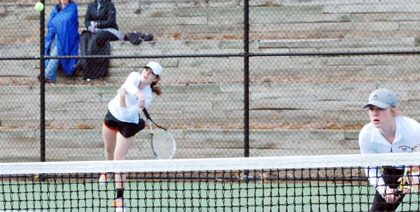 Harbor Springs Rae Claramunt (left) serves as partner Perry Bower looks on during a No. 1 doubles match against Charlevoix Tuesday at the Harbor Springs Community Tennis Courts. The Rams defeated the Rayders, 8-0, in both teams season opener.