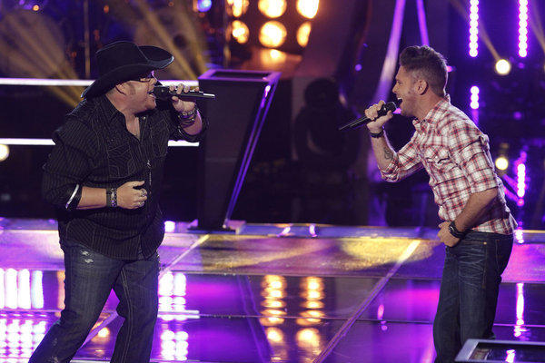 "Michael Austin (left) Warren Stone battle on ""The Voice."""