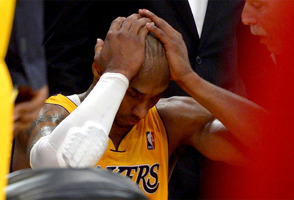 Lakers guard Kobe Bryant will be out the next six to nine months with a torn left Achilles.