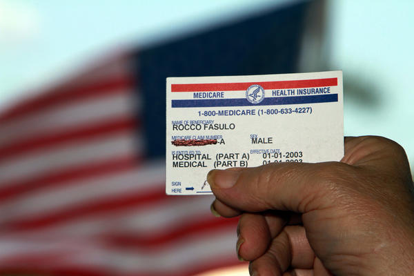 Rocco Fasulo holds his Social Security card at his Ft. Lauderdale home on March 6, 2012. Fasulo is a retiree who objects to Medicare using his Social Security number on his Medicare card, so he blacked out the number and tells doctors the number in person.