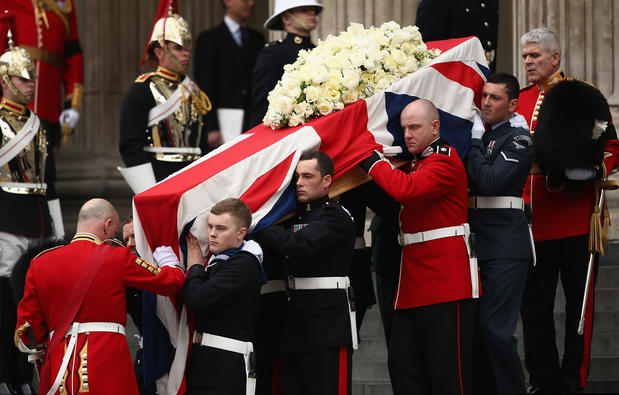 Members of the armed services carry the coffin after the funeral of former British Prime Minister Thatcher at St. Paul's Cathedral.