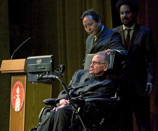 Physicist Stephen Hawking turns to face the audience on stage at Caltech in Pasadena on Tuesday.
