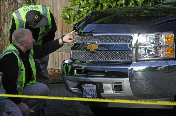 Seattle police investigate a dented pickup at the scene of an accident. Insure.com polled 1,000 married adults last month to find out how honest they are about owning up to traffic accidents, traffic tickets, auto insurance. They found husbands far more likely to lie about such things.