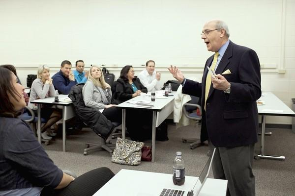 Professor John C. Draut teaches a management class at Benedictine University in Lisle.