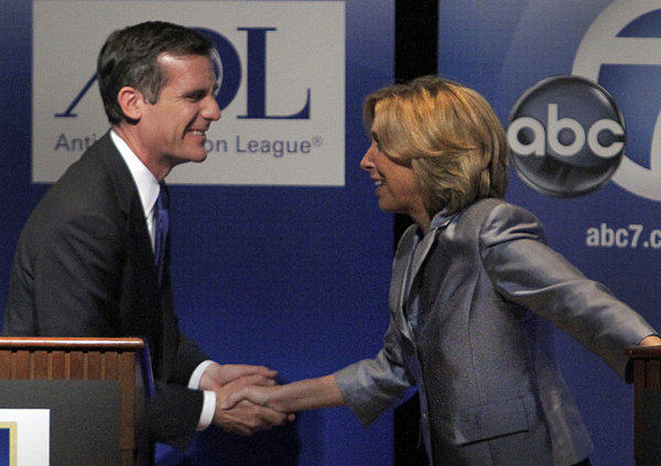 Mayoral candidates Eric Garcetti and Wendy Greuel shake hands after a debate.