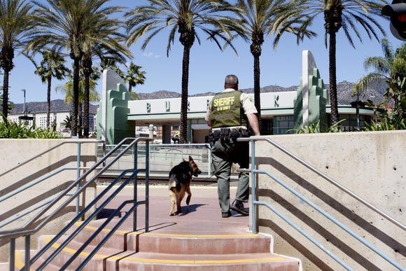 Los Angeles County Sheriff's Department officials investigate a bomb threat at a Burbank Metrolink station.