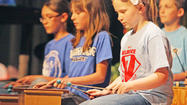 "It was a colorful performance in the West Jessamine High School auditorium Friday night as students from all five elementary schools presented music they've been working on all year — Dr. Seuss' ""My Many Colored Days."""