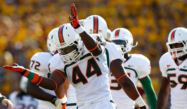 Eddie Johnson #44 of the Miami Hurricanes celebrates following a stop against the Boston College Eagles.