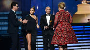 "<span style=""font-size: small;"">A few minutes on stage with Adele may cost Grammy Awards crasher Vitalii Sediuk six months in jail. Sediuk, who also kissed Will Smith at a Men In Black 3 premiere in 2012, has been officially charged for the incident. If convicted, he could be hit with a $1,000 fine or a jail sentencebe. ""The safety and protection of both participants and attendees of major events held in this city is a priority of my office,"" L.A. City Attorney Carmen Trutanich said in a statement (via E! News.) ""In this age of heightened security, any person who intentionally crosses that line and acts in an irresponsible manner will be held accountable for his or her actions."" Back in February, the Ukrainian TV host managed to make it all the way to the Grammy stage and even said a few words before presenter Jennifer Lopez took action. ""It's such an honor to receive this award,"" he said to the audience as Adele, 24, made her way up to accept the award for Best Pop Solo Artist. ""I love you, Adele."" He was later arrested on suspicion of trespassing. Lopez's rep reacted to the on-stage incident, telling ETonline, ""Like Adele said, [Lopez] is her 'good luck charm.'""</span>"