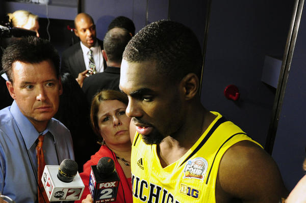 Michigan guard Tim Hardaway Jr. talks to the media after losing to the Louisville Cardinals in the championship game in the 2013 NCAA men's Final Four at the Georgia Dome.