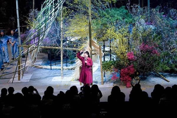 "Akane Teshigahara receives an ovation during a previous year's ""Iemoto Ikebana Live"" performance, during which the ikebana master uses an entire stage as her vase. For the first time, the production -- large enough to require a supporting cast of assistants -- will be staged in Los Angeles."