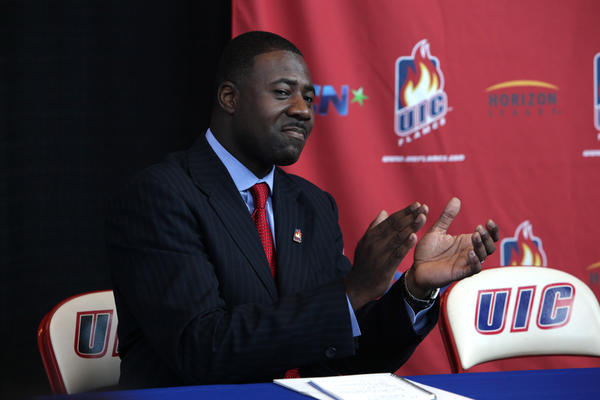 Howard Moore reacts after being named as UIC's new basketball coach in 2010.