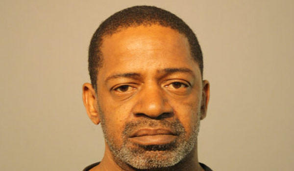 Keith Owens, 51, charged in the robbery and attempted murder of a shop owner. Police photo