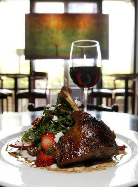 The tender duck confit on a bed of greens at Bistango in Irvine.