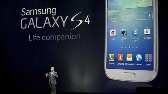 JK Shin, president and head of the IT and mobile communication division of Samsung, introduces the Galaxy S4 last month in New York.