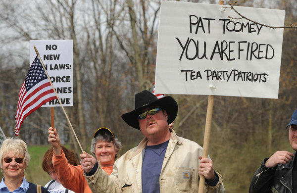 Protester Greg Hetherington demonstrates outside GOP Sen. Patrick J. Toomey's office in Johnstown, Pa., on Tuesday.