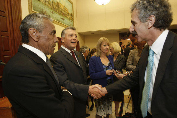 Challenger Mike Feuer, right, and City Atty. Carmen Trutanich shake hands at the start of a recent candidates' forum.