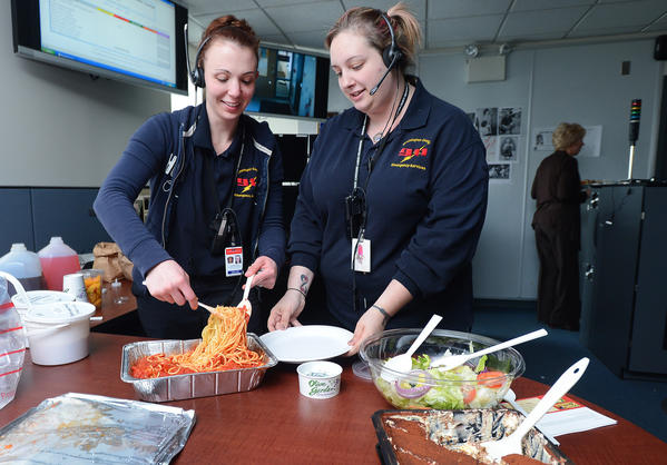 Washington County Emergency Communications Specialists Mandy Thomas, left, and Beth Carpegna, right, took a quick break from their jobs as fire and police dispatchers Wednesday afternoon to enjoy lunch courtesy of the Smithsburg Emergency Medical Service staff. This week is National Public Safety Telecommunications Week.
