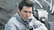 "Something's wrong. Tom Cruise, or, rather, Jack Harper, his character in the placid new science-fiction adventure ""Oblivion,"" can't shake his dreams of a woman giving him the big eyes on the observation deck of the Empire State Building."