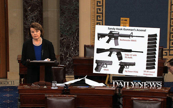 Sen. Dianne Feinstein (D-Calif.) uses a poster of weapons as she speaks about gun legislation on the floor of the Senate.
