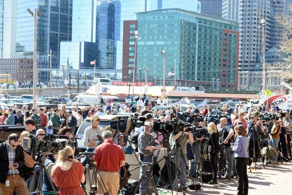 National and international media congregate outside the John Joseph Moakley Courthouse just prior to a code red Wednesday in Boston. The evacuation came as reporters gathered outside the courthouse amid speculation that a suspect was in custody from the Boston Marathon bombing.