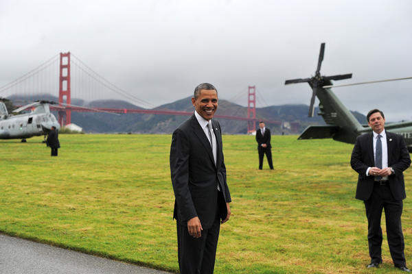 President Barack Obama smiles before boarding the Marine One helicopter in San Francisco.