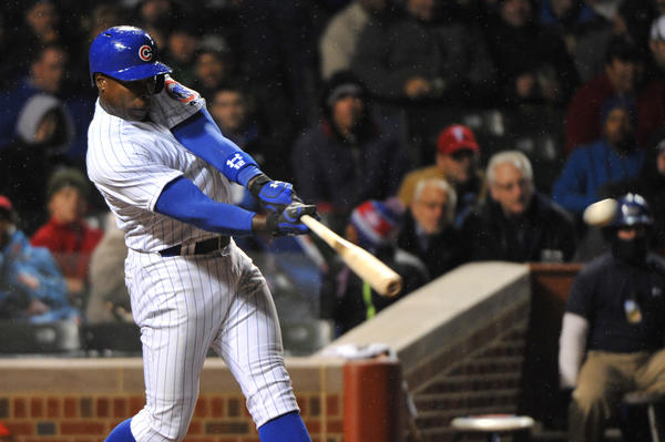 Alfonso Soriano hits a double against the Rangers during the fourth inning at Wrigley Field.