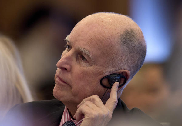 California Gov. Jerry Brown listens during a session on energy innovation and low-carbon development at Tsinghua University in Beijing.